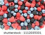 berries. raspberry  blueberries ...   Shutterstock . vector #1112035331