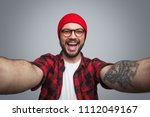 cheerful bright bearded hipster ... | Shutterstock . vector #1112049167