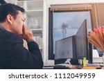 stressed businessman having... | Shutterstock . vector #1112049959