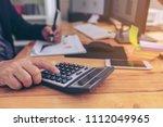 closeup of a young man checking ... | Shutterstock . vector #1112049965