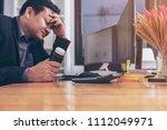 stressed businessman having... | Shutterstock . vector #1112049971