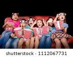 little kids watching movies... | Shutterstock . vector #1112067731