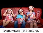 little kids watching movies... | Shutterstock . vector #1112067737