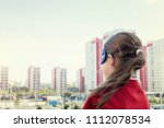 superhero kid against urban... | Shutterstock . vector #1112078534