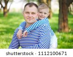 little funny boy with father   Shutterstock . vector #1112100671