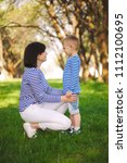 little funny boy with mother   Shutterstock . vector #1112100695