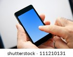 Small photo of Businessman monitor the progress of their actions on-line with his smart-phone