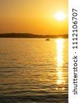 Orange Vertical Sunset On The...