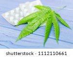 marijuana and pills. leaf of... | Shutterstock . vector #1112110661
