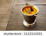 north india food tadka dal in... | Shutterstock . vector #1112111021