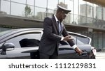 attentive taxi driver politely... | Shutterstock . vector #1112129831