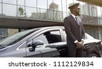 cheerful afro american taxi... | Shutterstock . vector #1112129834