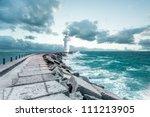 Lighthouse And The Waves