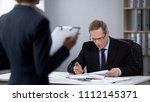 business man worried about work ... | Shutterstock . vector #1112145371