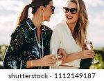 beautiful young women walking... | Shutterstock . vector #1112149187
