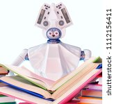 robot teacher with book for kid.... | Shutterstock . vector #1112156411