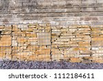 gabion cages filled with stone. | Shutterstock . vector #1112184611