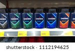 Small photo of Klang, Malaysia - June 12, 2018 :Various type of Dashing Man Talcum for sale at supermarket shelf.