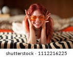 pretty young woman with red... | Shutterstock . vector #1112216225