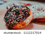 chocolate and vanilla donuts | Shutterstock . vector #1112217014