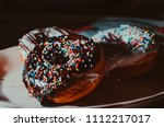 chocolate and vanilla donuts | Shutterstock . vector #1112217017