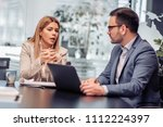 two business colleagues working ... | Shutterstock . vector #1112224397