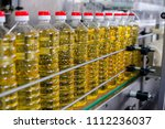 sunflower oil. factory line of... | Shutterstock . vector #1112236037