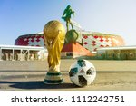 Small photo of April 9, 2018 Moscow, Russia Trophy of the FIFA World Cup and official ball Adidas Telstar 18 against the backdrop of the Spartak stadium, where the World Cup 2018 matches will be held.