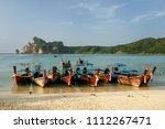 longtail boats anchored at ao... | Shutterstock . vector #1112267471