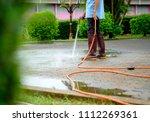 worker spraying water to clean... | Shutterstock . vector #1112269361