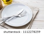 empty plate spoon fork and... | Shutterstock . vector #1112278259
