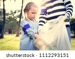 kids picking up trash in the... | Shutterstock . vector #1112293151