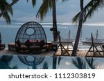sunset on the the pool  coconut ... | Shutterstock . vector #1112303819