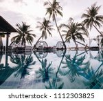 sunset on the the pool  coconut ... | Shutterstock . vector #1112303825