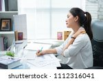 asian women aches from working... | Shutterstock . vector #1112316041