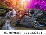 waterfall beautiful in rain... | Shutterstock . vector #1112331671