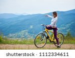 sporty female cyclist riding on ... | Shutterstock . vector #1112334611