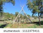 wooden frame of tipi tent | Shutterstock . vector #1112375411