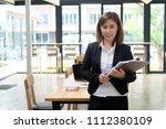 portrait shot audit asian woman ... | Shutterstock . vector #1112380109