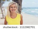 attractive tanned older blond... | Shutterstock . vector #1112382701