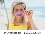 stylish blond woman with trendy ... | Shutterstock . vector #1112382704