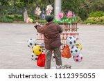 chinese old man street vendor... | Shutterstock . vector #1112395055