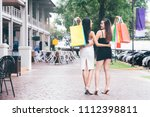 happy young women with shopping ... | Shutterstock . vector #1112398811