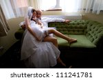 Sexy bride with groom on the sofa - stock photo