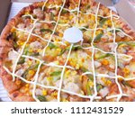 close up of fresh pizza | Shutterstock . vector #1112431529