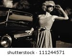 Woman near a retro car outdoors - stock photo