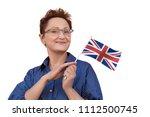 woman holding flag of uk united ...   Shutterstock . vector #1112500745