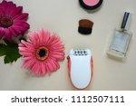 epilator and gerbera flowers  ... | Shutterstock . vector #1112507111