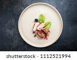 fried pork fillet with salad...   Shutterstock . vector #1112521994
