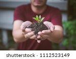 two hands of the men were... | Shutterstock . vector #1112523149